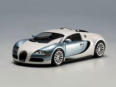 This Bugatti EB 16.4 Veyron Diecast Model Car is Pearl and Ice Blue and features working wheels. It is made by AUTOart and is 1:43 scale (approx. 11cm / 4.3in long).    Please note: AutoArt have now discontinued this model - limited stock available....