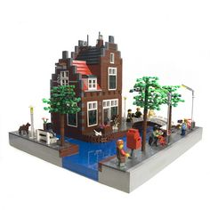 This is my latest MOC: A Dutch Canal House. It took me a while to finish it, because I rebuild the base with the canals for a few times.   Visit my own Lego Website:  www.mrbrick.nl