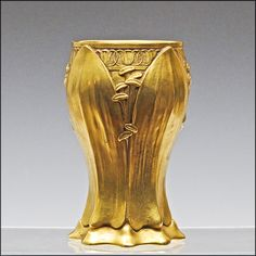 A marvelous period Art Nouveau bronze vase designed by the French artist Leon Kann who was active from 1896-1908, and cast at the world renowned