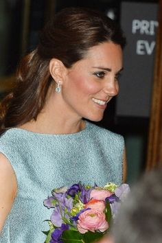 Catherine, Duchess of Cambridge leaves after attending an evening reception at The National Portrait Gallery
