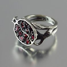 POMEGRANATE garnet silver ring. $380.00, via Etsy.