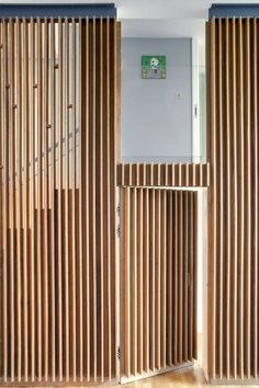 Image 6 of 16 from gallery of Apartment at Bow Quarter / Studio Verve Architects. Photograph by Luke White Timber Battens, Timber Cladding, Timber Door, Wood Slat Wall, Wood Slats, Wooden Walls, Wood Front Doors, Entry Doors, Front Entry