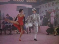 "Cyd Charisse and Fred Astair from ""The Bandwagon"". My favorite number in all the musicals of the 1950's.  I want that red dress and shoes!"