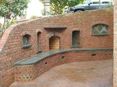 The striking brick outdoor fireplace designs featured here are beautifully… Build Outdoor Fireplace, Brick Fireplace Wall, Outdoor Fireplace Designs, Backyard Fireplace, Outdoor Fireplaces, Outdoor Living Areas, Outdoor Spaces, Outdoor Decor, Outdoor Ideas