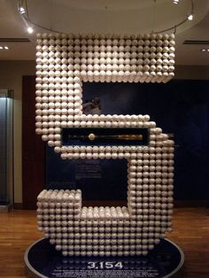 The George Brett #5 display with 3,154 baseballs and the bat he used to collect is 3,000th hit.