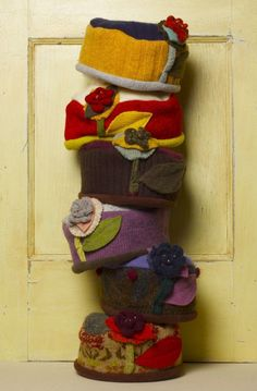 Beautiful hats from recyled sweaters by Denton artist Leslie Kregel at Cimarrona Amjay??