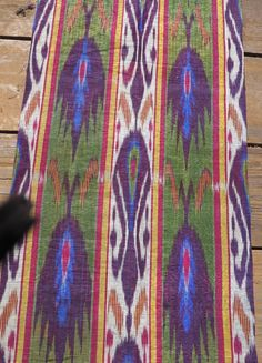 Uzbek Adras Ikat Panel. Late 19th century. 17x46 inches (43x117 cm) six colors. Excellent condition. No stains, tears or color run.