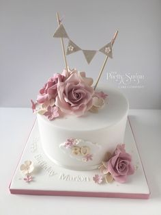 Vintage style 80th birthday cake with sugar roses and bunting topper #vintage_style_cake