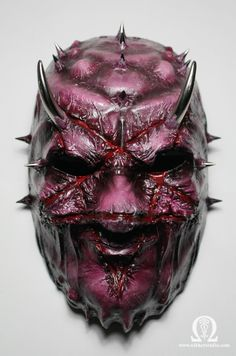 Demon mask with engraved pentagram and spikes