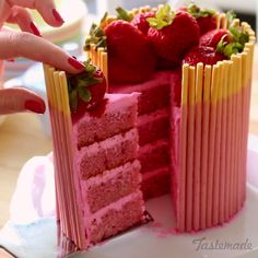 Your favorite biscuit straw snacks, as a cake! This cake is full of strawberry goodness, including the beautiful strawberry Pocky placed around the cake!