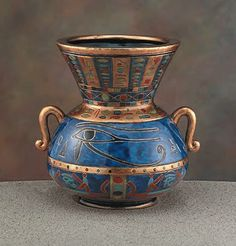 Eye of Horus ceramic vase, gold and blue ~Repinned Via Ahmed Abdalrazik http://www.veniceclayartists.com/ancient-egyptian-art-and-pottery/