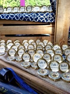Nautical wedding theme: compasses with table numbers to escort guests to their seats | ©Sterling Events Group