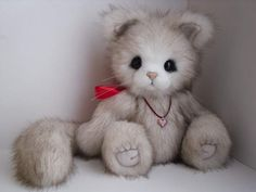 Misty By Steffan Teddy Bear - Kitten is sewn from high quality faux fur. She has black eyes made of German glass. The nose is made of plastic. Kitten has a unique handmade pendant. Misty is 5 fully articulated cat can, move their arms, legs and head. He is filled with soft anti-allergic PolyFill, steel and hea...
