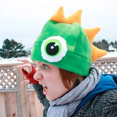 Keep your head warm and oh so fierce with a cozy, funky monster hat. Bulging eyes and colourful spikes.