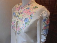 Pastel floral embroidered cutwork peasant blouse