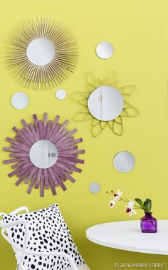 Get catalog-worthy sunburst mirrors for less by crafting them yourself out of DIY staples. Top: paper straws. Middle: strips of cardstock. Bottom: strips of wood.