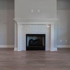 I like the subway tile Subway Tile Fireplace, Tile Around Fireplace, White Fireplace Surround, Reface Fireplace, Brick Fireplace Makeover, Farmhouse Fireplace, Fireplace Surrounds, White Fireplace Mantels, Fireplace Update
