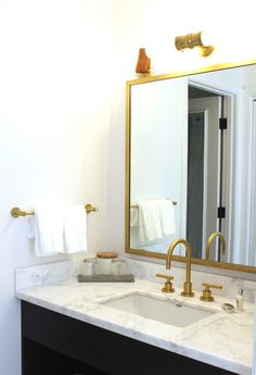 Brass and gold fixtures in white marble granite bathroom at Scandinavian designed boutique hotel The Landsby in Solvang just outside of Santa Barbara | theprettycrusades.com