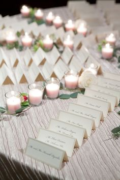 escort card table set up, very pretty with the candles