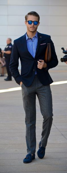 Go for a classic style in a navy blue blazer and charcoal wool dress pants. Opt for a pair of blue suede tassel loafers for a more relaxed aesthetic. Shop this look for $257: http://lookastic.com/men/looks/sunglasses-long-sleeve-shirt-zip-pouch-blazer-dress-pants-tassel-loafers/7523 — Blue Sunglasses — Blue Vertical Striped Long Sleeve Shirt — Brown Leather Zip Pouch — Navy Blazer — Charcoal Wool Dress Pants — Blue Suede Tassel Loafers