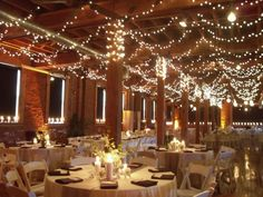 christmas lights on the ceiling are affordable and gorgeous for winter wedding decorations c: