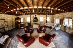 cozy seating area with leather chairs at Mayowood Stone Barn in Rochester MN | Photo: Janelle Elise Photography