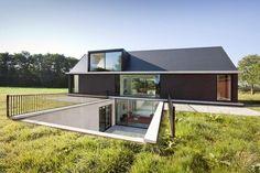 Modern Barn Style Home Showcases Glazings and Below Grade Ramp