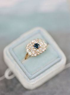 Gorgeous + unique diamond and sapphire engagement ring: http://www.stylemepretty.com/2015/12/21/elegant-southern-wedding-inspiration/ | Photography: Elisa Bricker - http://elisabricker.com/