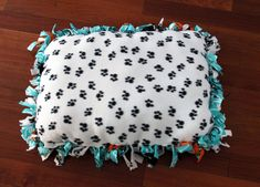 diy pet pillow: Yay! here's an easy one I can make with all those airplane blankets!