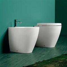 Sanitari filo parete design moderno stondato in ceramica e sedile frizionato