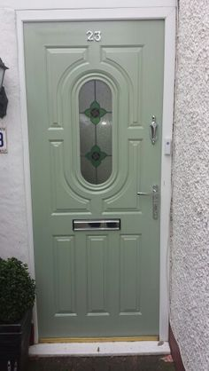 Drab white pvc front door transformed with clever paint and new chrome furniture