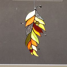 Stained Glass Orange and Yellow Suncatcher by FoxStainedGlass Mosaic Projects, Stained Glass Projects, Stained Glass Patterns, Stained Glass Art, Stained Glass Windows, Mosaic Glass, Fused Glass, Tiffany Art, Yellow Feathers