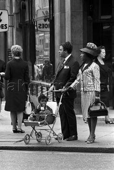 Mario De Biasi, A mixed couple with a baby on a pram, akg-images / Mondadori Portfolio