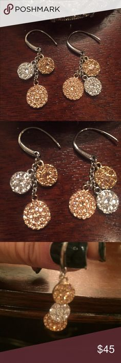 Fossil Stunning 3 Tone Earrings These are beautiful pave earrings. 3 different metals make these so versatile!! Gold, silver and rose gold. All adorned with beautiful crystals!!! Only worn once. I'm also selling the studs in rose gold separately.  Jewelry Earrings