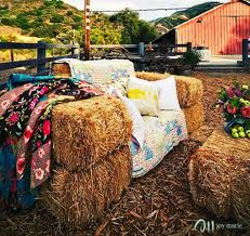 Hay bale couch. Hay bales bring both a rustic and festival vibe.  Cheap and warm to sit on.
