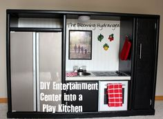 This is so cute! I don't have girls, but had to pin anyway. DIY Entertainment Center Into a Play Kitchen
