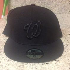 d5febdb1ab4 All black Washington Nationals hat All black Washington Nationals hat.  Never used. Size 7