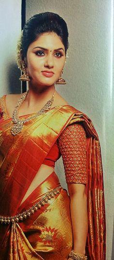 South Indian Bride. Gold Indian bridal jewelry.Temple jewelry. Jhumkis. Orange and gold silk kanchipuram #Saree. braid with fresh jasmine flowers.