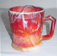 Here is a pretty satin glass ruby slag mug that was made by Imperial. It has robins molded on the sides and is marked with the I over G Imperial mark in the inside bottom of the mug. It stand 3.5 inch