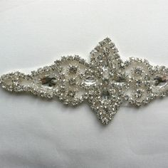 A personal favorite from my Etsy shop https://www.etsy.com/listing/123132476/rhinestone-applique-1-piece