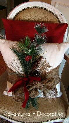 And, want an inexpensive way to make a Christmas pillow?  Just add a burlap bow to a pillow you already have and tuck a piece of pine or a wintery mix into the bow and voila!