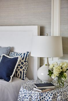 Chic bedroom features gray grasscloth paneled walls lined with a crisp white headboard on bed ... Blue Bedroom Decor, Home Bedroom, Bedroom Furniture, Master Bedroom, Awesome Bedrooms, Beautiful Bedrooms, White Headboard, White Bedding, How To Dress A Bed