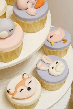 Don't miss this adorable bunny ina hot air balloon birthday party! The cupcakes are adorable! See more party ideas and share yours at CatchMyParty.com #catchmyparty #partyideas #bunnyparty #girlbirthdayparty #woodladnanimalcupcakes