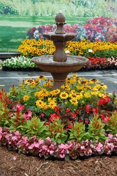 I would love to have something like this in my garden. Flowers around fountain pictures - Google Search