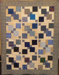 A serene Disappearing Nine Patch quilt top.