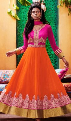 Celebrate specials moments with your loved ones dressed in this orange and pink color georgette, tissue Anarkali suit. The ethnic lace, resham and stones work for dress adds a sign of attractiveness statement for your look. #TrendyRaniAndOrangeColorAnarkali