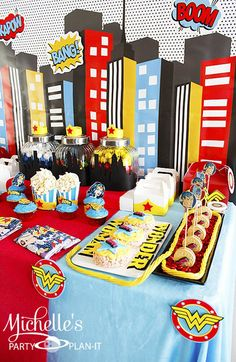 Wonder Woman Party with So Many Awesome Ideas via Kara's Party Ideas | KarasPartyIdeas.com  Like the cityscape