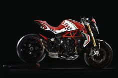 MV Agusta Dragster 800 RC -- What do you get if you take an Italian street fighter and splice in some sports bike DNA? One answer could be the new 2017 Reparto Corse model MV Agusta Dragster 800 RC. MV Agusta make beautiful bikes, there's no question about that, aggressive in look and standing. On the performance side, the 800 RC's three-cylinder engine produces 140 hp at 13100 rpm.