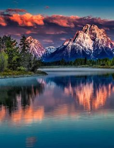 Mount Moran Sunrise [Mount Moran is a mountain in Grand Teton National Park of western Wyoming, USA. The mountain is named for Thomas Moran, an American western frontier landscape artist.] sunset scene, pink and purple clouds Cool Pictures, Cool Photos, Beautiful Pictures, Beautiful Nature Photos, Best Nature Photos, Beautiful Scenery, Pics Of Nature, Calming Pictures, Nature Images