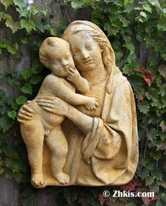 Madonna and Child Wall Plaque - Mary and Child Wall Plaque.This wall piece has great depth of 5 inches - is 18 inches high - 13 inches wide. Made of durable fiberglass outdoor suitable. Comes in several color choices.